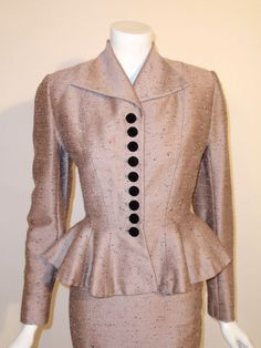 1940   Lavender Shantung Peplum Suit with a Black Fabric Covered Buttons by Lilli Ann