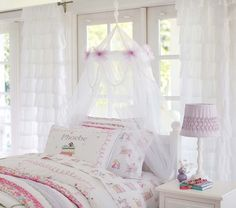 Classic Tulle Canopy | Pottery Barn Kids.  We can add a decorative garland (to be selected) to the top as shown here.