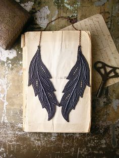 Feathery things. I love that this looks similar to a collar, and the lace is certainly a plus!