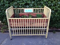Re-purpose the kids crib for an herb garden!