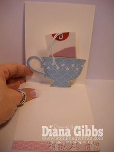 pop up!  ... You could all so just make a teacup pocket with a slid out tea bag with all the details for a tea party.