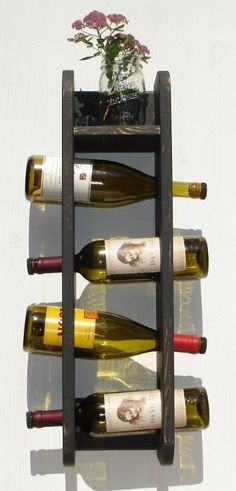 Wine Rack - Wall Hanging with shelf - Holds 4 Bottles - Rustic Black. $34.95, via Etsy.