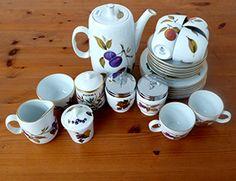 An Evesham pattern Royal Worcester six setting breakfast coffee set