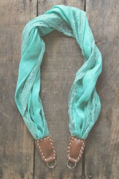 LOVE the idea of a scarf camera strap... I need to get one of these!!!