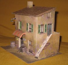 Here is a paper model I would like to have created:  this Casa E Bottega (House With Grocery Store, in a free translation)  was created by ...