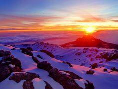 A well-earned sunrise at Mt. Kilimanjaro, Tanzania. Photo is by Tze Ru Pang.