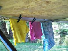 sheltered clothes lines on pop-up camper, because many state/national parks do not allow tying lines to trees...