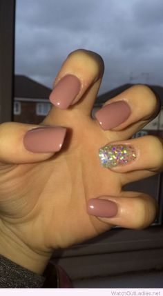 Nude nails with colorful glitter details