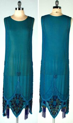 ~Dress ca. 1920s~ Deep turquoise/teal silk crepe covered in shiny glass beads. Beaded tassel hem with pointed edge. No side or back closure - slips over head. Mill St. Vintage/etsy