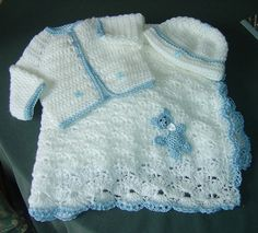 . The jacket pattern is based on one of the free baby crochet patterns from Ravelry. Crocheted in double knit with tiny teddy bears (Abakhan) stitched on an using a blue silky DK yarn for the contrast trim.  The pram blanket is made from a simple shell patterns and the teddy trim is crocheted from a free pattern from Ravelry.  The hat is a basic beanie pattern with a teddy bear motif added.