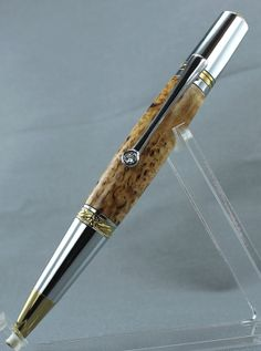PEN: Majestic Squire twist pen. Barrel of Masur Birch. The high figure found in this wood is caused when the tree heals the damage done by an invasive boring beetle. The beetle infestation leaves the trees stunted and sometimes deformed but produces wood with small twists and swirls that highlight the darker, burly figure. Rare!! Comes with beautiful Swarovski crystal in the clip. Finish is a lavish chrome and gold. $97.00