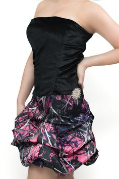Visit www.atouchofcamo.com to purchase!!  Braley style, short CAMO pick up skirt, velvet strapless top is $295 for 2018 prom. Shown in Muddy Girl camo w/ black velvet bodice and side accent rhinestone  brooch.