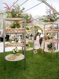 3-tiered outdoor buffet stands holding pre-made cocktails and appetizer bites.
