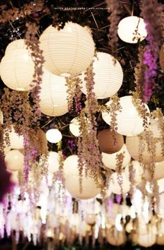 Adore this garden style mixed with glowing white paper lanterns. Unique and beautiful wedding idea #loveatfirstlight