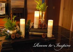 Buy cheap candles from Dollar General and cover them with sheet music. very pretty.