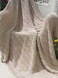 """Description: """"This lovely quick-to-knit afghan is worked in a solid color, but with a reversible striped texture."""""""