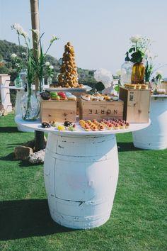 Wedding decor Marbella, Spain Dessert buffet on old wine barreos. Flowers by L&N Floral Design