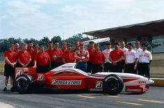 Jos Verstappen together with the Bridgestone crew during a test session for the new tires. The company was preparing its entrance in Formula 1 in 1997.  The car is a Ligier JS41 powered by a Mugen Honda MF-301h, 2,998 cc (182.9 cu in), 72° V10, NA, mid-engine, longitudinally mounted.  1996