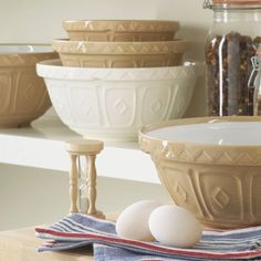 Mason Cash bowls - Mason Cash is nowadays a name synonymous with domestic kitchenware, in particular the cane mixing bowl, which is considered a design classic. The traditional partner to the famous cane mixing bowl has always been the classic white pudding basin. Recognised worldwide, this piece of pottery is still used in the British Royal Household for plum and Christmas puddings!