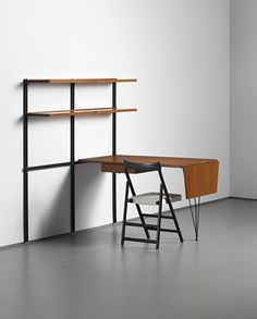Osvaldo Borsani intergrated modular shelving unit and desk, model no. E22, desinged 1947, with folding chair, model no. S 80, circa 1955.