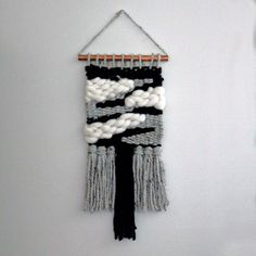 Handmade wall weaving that will fit into any decor!  Perfect for a living area, bedroom, or even a nursery.  Made with a mix of natural fibers (merino wool and cotton), this woven tapestry is a one of a kind weaving that will definitely make a statement!  Beautiful neurtral color scheme that not only will coordintate to any decor, but the soft white merino wool, gives off a great feeling of coziness!  Measurements:  1/2 Coppe Pipe: 9.75 wide Weaving: 8.5 wide, 18.5 long (from pipe down to…