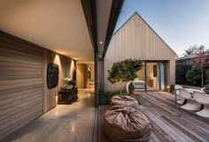 House-shaped blocks and courtyards make up thiscedar-clad residence in Christchurch, New Zealand, designed by architect Case Ornsby.
