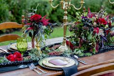 Our Alice in Wonderland inspired table is perfect for the bride and groom hosting a fall wedding. Use deep red and purple against gold, black and green like we did for a romantic, chic and inviting reception table