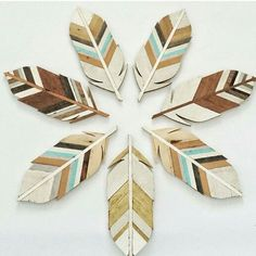 """Coveting these beautiful handmade wooden feathers for our """" Woodland Dreamland """" nursery from jlwoodworx.com."""