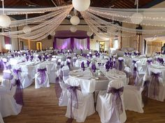 Recreate: white polyester chair covers and tablecloths, plum organza sashes, silver satin runners, and Organza 40 yds fabric rolls for ceiling drapes www.cvlinens.com