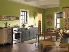 Greens can live on and off the plate in this vibrant kitchen with walls in Parakeet (SW 6711).