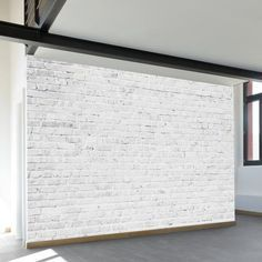 An exposed brick wall in a room doesn't always mean industrial. Moreover if we talk about the specific white brick wall, the style and design it suits will be way more than just one kind. The range is wide as . Faux Brick Walls, White Brick Walls, White Bricks, White Stairs, Brick Tiles, Wall Mural Decals, Removable Wall Murals, Wall Art, Brick Effect Wallpaper
