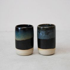 Double dip over white clay- black and then a beautiful translucent glaze. japanese ceramics