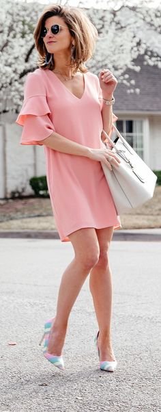 #spring #outfits woman wearing pink dress and holding bag. Pic by @brightonkeller