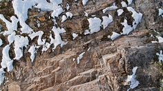 Winter Texture V: A week of abstract textures inspired by the frigid beauty of Canadian winter. Today, we have the rich organic texture of a glacier carved cliff face dusted with snow and lichen.