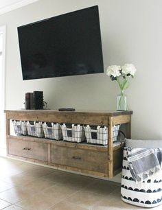 Free building plans to build your own modern DIY TV Console table. With plenty of storage, plus functionality, this modern TV Console is easy to build and stained in a gorgeous minwax provincial. Floating Tv Console, Tv Console Modern, Floating Vanity, Console Table, Floating Media Shelf, Rustic Tv Console, Floating Tv Stand, Console Tv, Furniture Plans