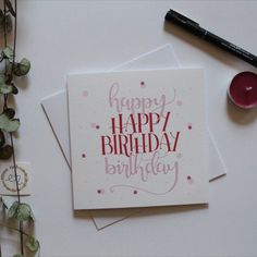 """Celebrate someone's birthday with this lively card with colours of red and pinks. With 2 sets of hand lettered """"happy birthday"""", it is sure to grab the receiver's attention. The design is also enhanced with fun and bubbly polka dots placed around the text. #calligraphy #handlettering #card Happy Birthday Calligraphy, Pink Birthday, Happy Birthday Cards, White Envelopes, Red And Pink, Texts, Card Stock, Polka Dots, Banner"""