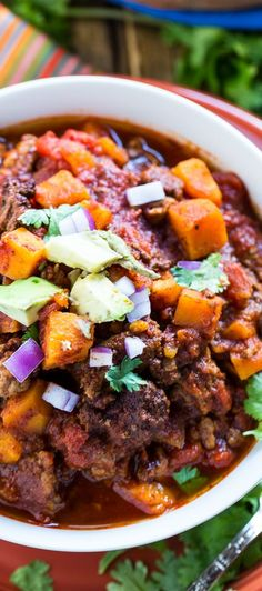 This Beef and Sweet Potato Chili is loaded with ground beef and tender chunks of sweet potato and cooked in a crock pot. I'm a huge fan of sweet potatoes in chili. Not only does it add lots of good nutrition,  but the sweetness tastes wonderful with all the spices a good pot of chili has.