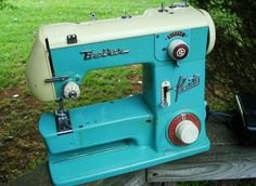 vintage blue and red Brother sewing machine