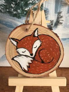 Sleeping Fox Wood Slice Ornament : Sleeping Fox Wood Slice Ornament by michellemarcusart on Etsy Fox Ornaments, Painted Ornaments, Wooden Ornaments, Ornament Crafts, Diy Christmas Ornaments, Xmas Crafts, Crafts To Sell, Diy Crafts, Wood Slice Crafts