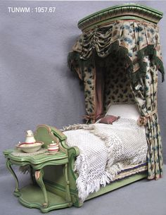 https://flic.kr/p/ABMqfR   Doll's house bed, about 1840   Bed from Rigg Doll's House, about 1840. On display at Tunbridge Wells Museum & Art Gallery.