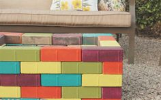 She Spray Painted Bricks And Started Stacking Them In The Backyard. The End Result? PERFECT For Summertime!
