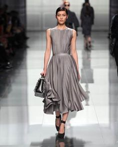 Grey pleated dress. Loving the clean lines but it's also flowy.  Dior Autumn/Winter 2012