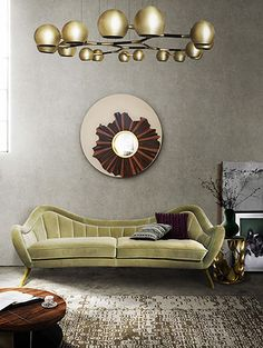 The golden and modern ceiling lamp reminds us physics and new discoveries from a vintage era. The pendant light is inspired by the 60's era of space exploration and is made of brass and steel. The vintage light green sofa and the round mirror contrast with the unique chandelier's lines. The light fixture aims to resemble the orbit of the planets.