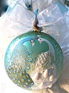 Say I love you with Peacocks!!!!!!!!!!!!!!!!!!    A truly beautiful handpainted work of art,,,perfect for any day of the year. The sparkle from this ornament is just unbelievable...the photos do not do it justice.... I guarantee once you receive this item,,,you will definately fall in love with it!!!!  EXTRA LARGE glass ball acrylic hand painted exotic birds accented with fine glitter, Swarovski crystals and pearls. Then topped with multiple exquisite ribbons and then highlighted with a…