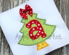 Personalized, appliqued  Christmas tree with initial and bow tshirt or onesie.
