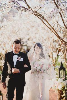 Cherry blossoms as stunning wedding decor for outdoor Bali wedding // Wilson and Vania's Sakura Garden Wedding at Alila Villas Uluwatu