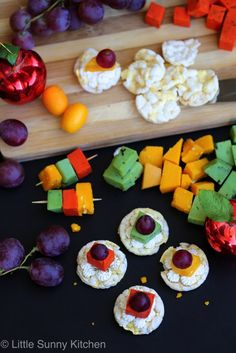 Cheese board canapés with grapes and rice cakes