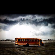 School bus on the beach during a storm. Corpus Christi, Texas.