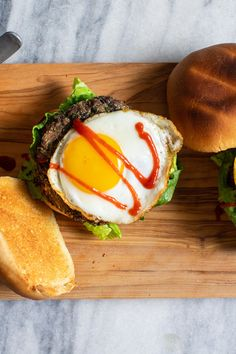 NYT Cooking: This is a vegetarian burger that does not mimic the texture or look of ground meat, but it isn't meant to. It's more like the most excellent refried beans. Though you can serve this well-seasoned patty like a traditional burger, on a bun with the usual condiments, it is at its best topped with a fried egg. Dusted with fine cornmeal, the burgers are pan-fried as the mixture is too soft to grill....