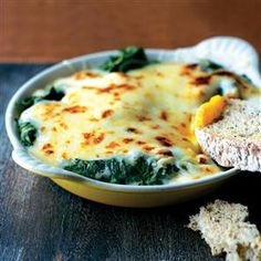 Spinach, eggs, cheese sauce - voila! a lovely easy dinner. Re-pinning this as I seem to have lost it somewhere in the ether.